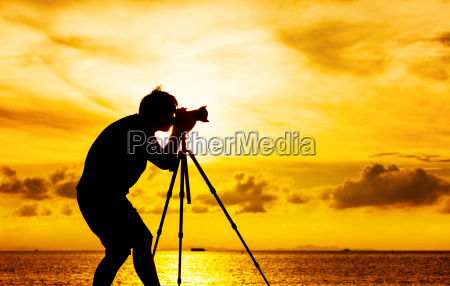 silhouette, of, photographer, with, tripot, at - 10094206