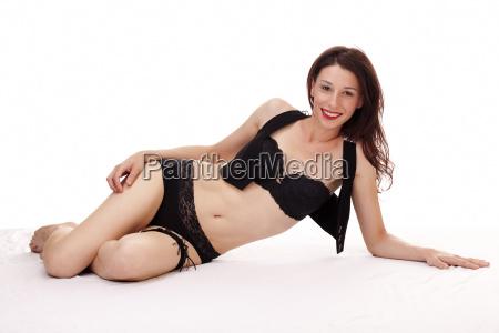 skinny caucasian woman reclining in black