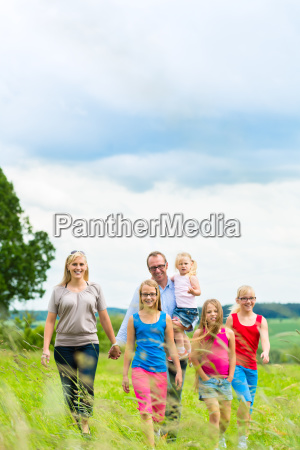 happy, family, running, in, a, meadow - 10102116
