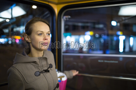 pretty young woman on a streetcartramway