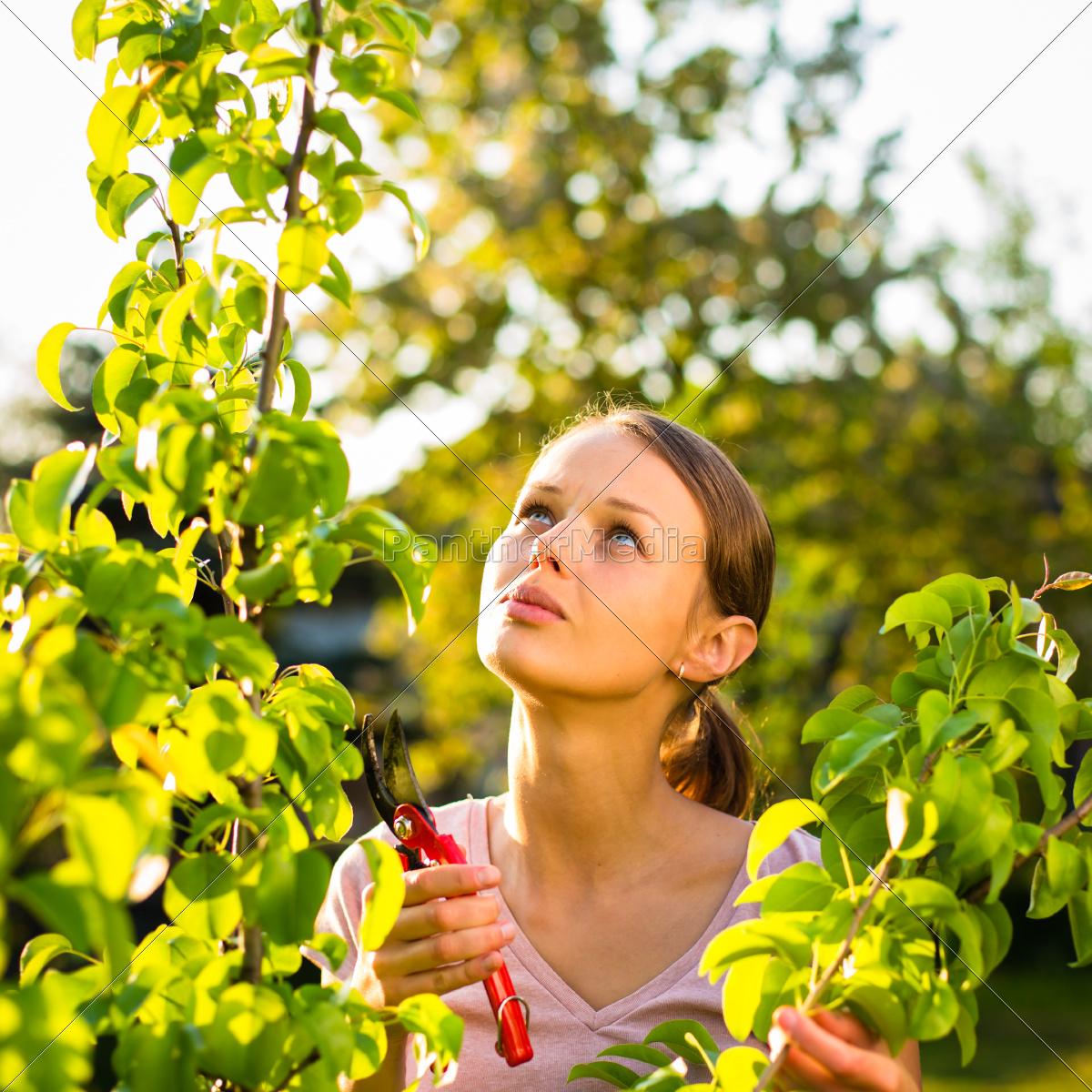 pretty, female, gardener, taking, care, of - 10110695