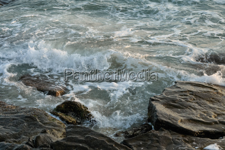 sea waves beating against the rocks