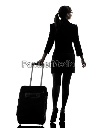 rear view business woman traveling