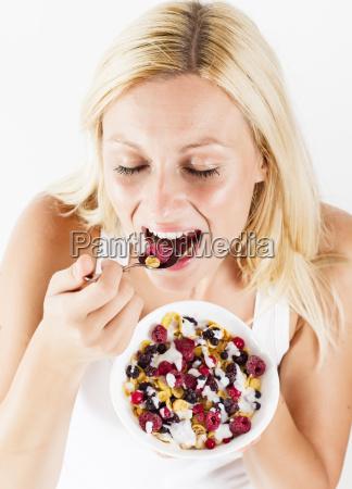 happy, blonde, woman, eating, muesli - 10112059