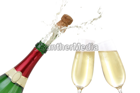 sparkling wine splashing out of a
