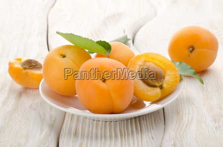 apricots in a white plate