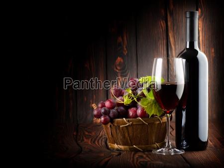 wine on the dark wooden background