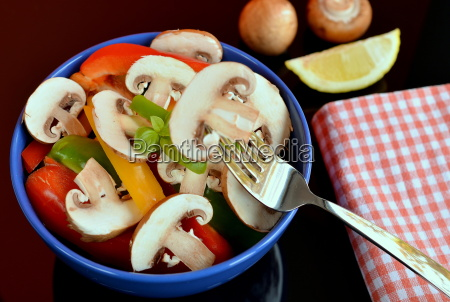 raw salad with champignon and paprika