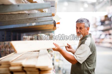 senior, man, buying, construction, wood, in - 10148081