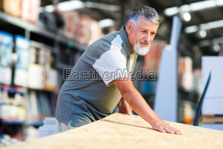 senior, man, buying, construction, wood, in - 10148093