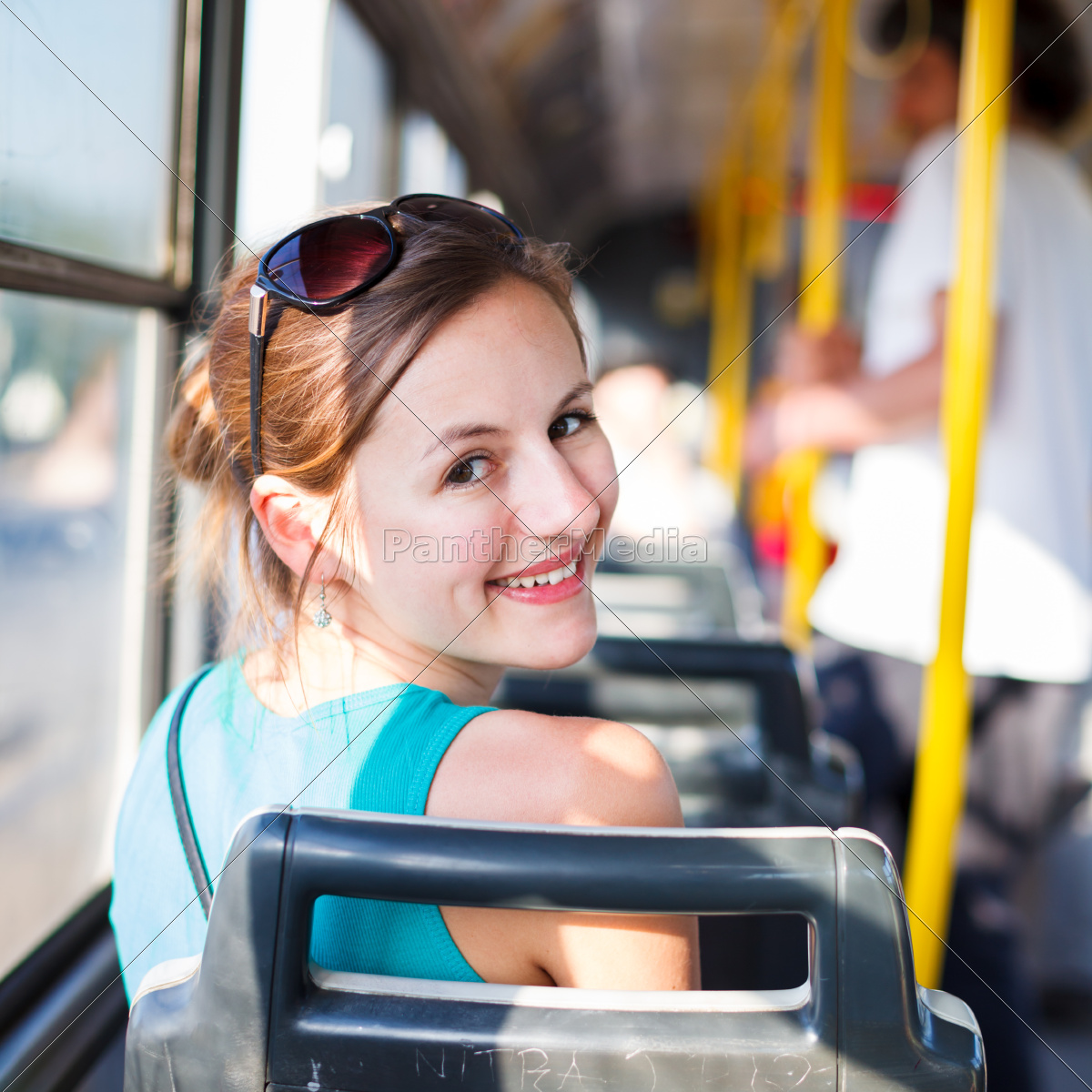 pretty, , young, woman, on, a, streetcar/tramway, - 10149987