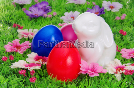 easter eggs on flower meadow