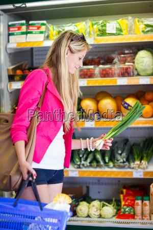 beautiful, young, woman, shopping, in, a - 10150081