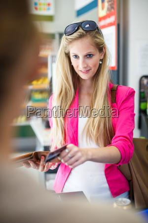 beautiful, young, woman, shopping, in, a - 10150095
