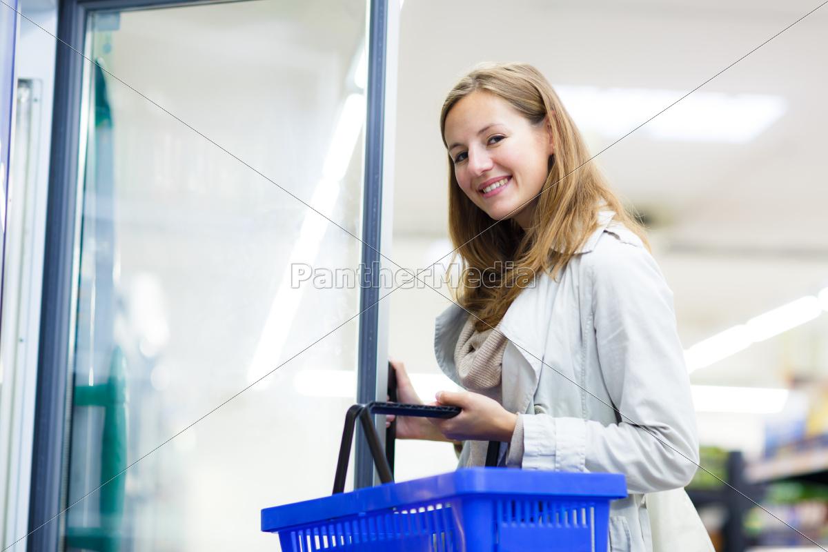 beautiful, young, woman, shopping, in, a - 10150163