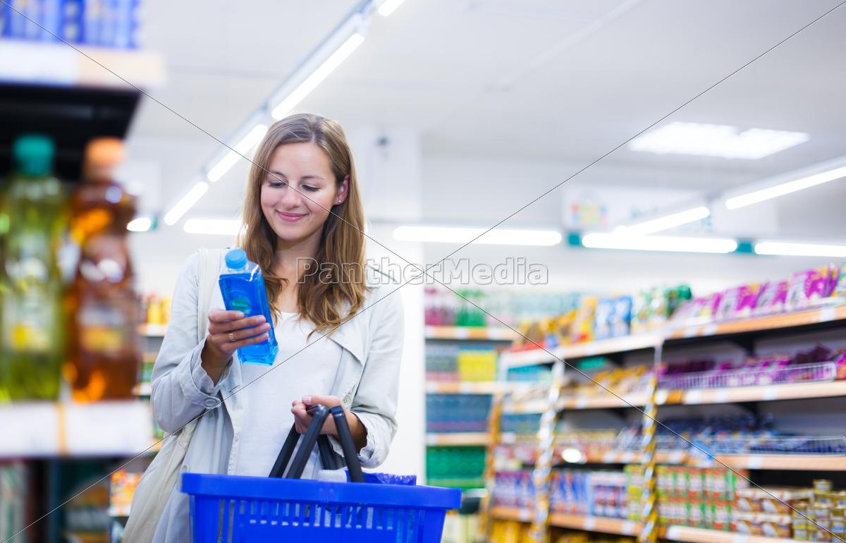 beautiful, young, woman, shopping, in, a - 10150173