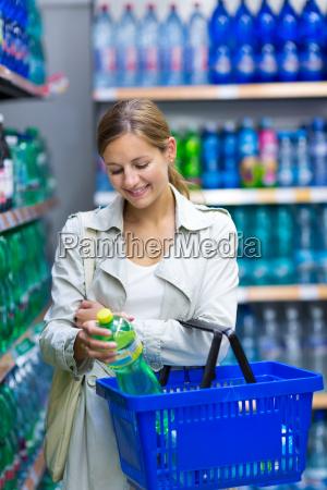 beautiful, young, woman, shopping, in, a - 10150205