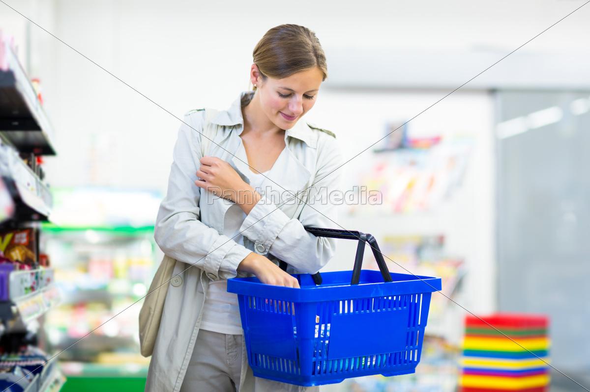 beautiful, young, woman, shopping, in, a - 10150223