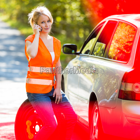 young, female, driver, wearing, a, high - 10150049