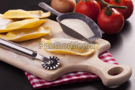 raw tortellini on a chopping board