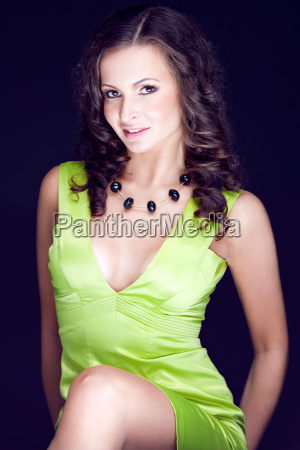 beautiful brunette in green dress