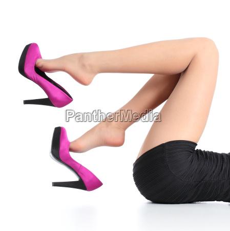 beautiful woman legs with a fuchsia