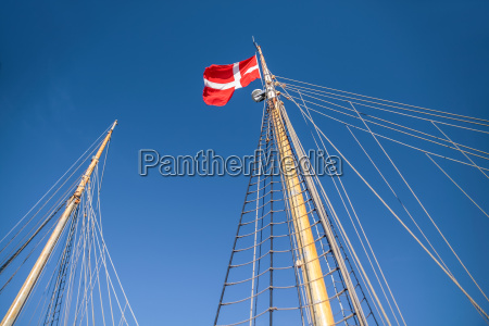 mast and danish flag on a