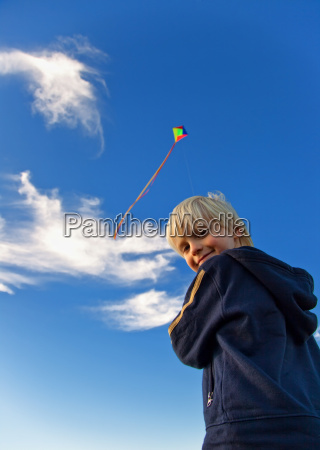 boy with kite in the wind