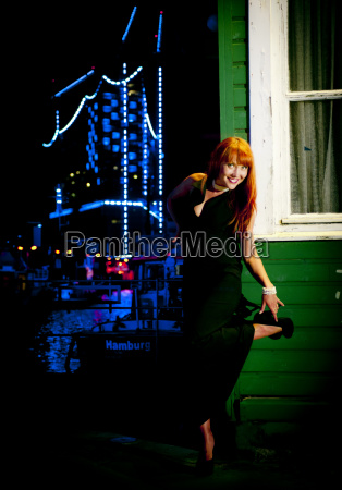 red haired woman on a pontoon