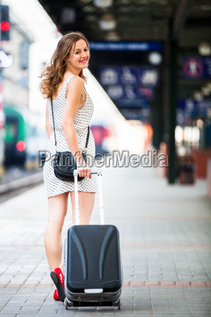 pretty young woman at a train