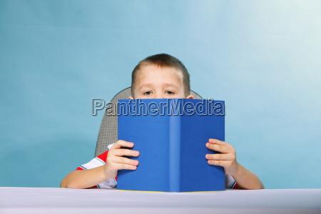child boy kid reading a book