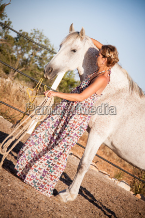 young female horsewoman trained her horse