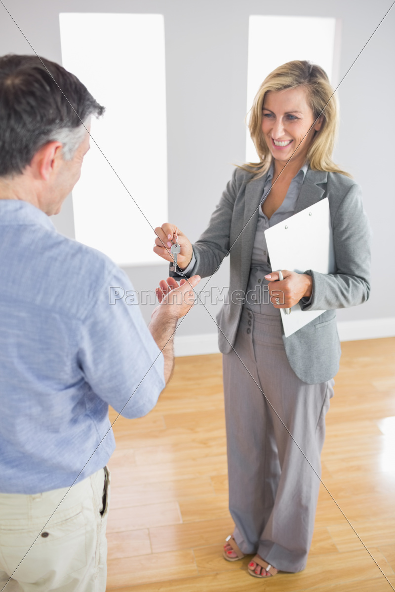 laughing, realtor, holding, a, briefcase, and - 10209885