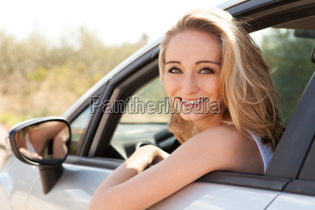 young, laughing, woman, in, car, window - 10215769