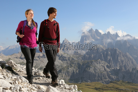 young people walking in the mountains