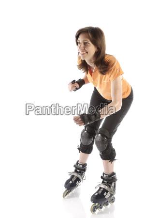 adult woman rides inline skates