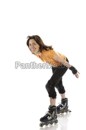 adult woman goes in line skates