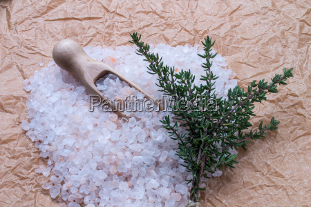 salt with measuring spoon and thyme