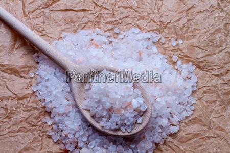 salt coarse with wooden spoon