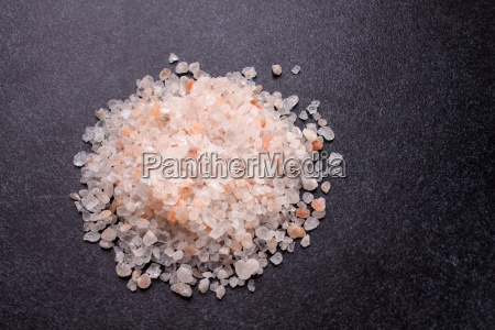 coarse rock salt on granite slab