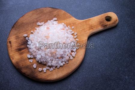 coarse salt on round wooden board
