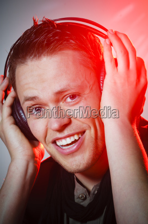 young man listening to music