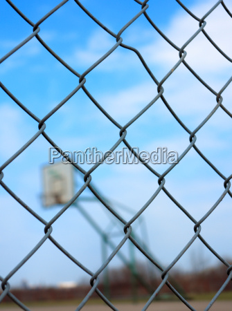 metal mesh with blur basketball court