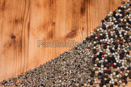 pepper colorful semicircular on wooden board