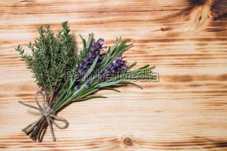 lavender rosemary thyme on wooden board