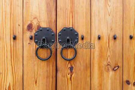 metallic, door, knob, with, wooden, door - 10262833