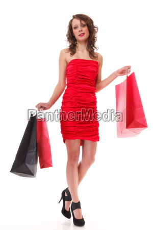 elegant young woman with shopping bags