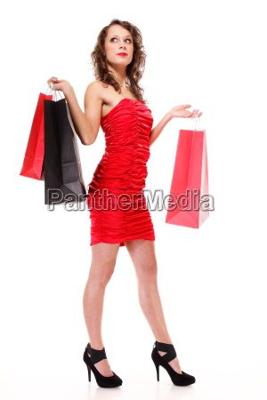 happy cheerful full length shopping woman