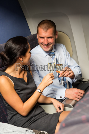 smart couple travel by airplane toasting