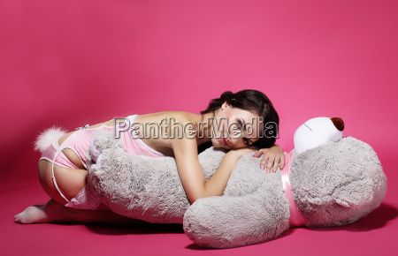 tenderness sentiment daydreaming woman with teddy